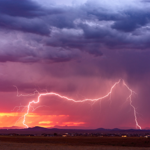"""Lightning strike at sunset"" stock image"