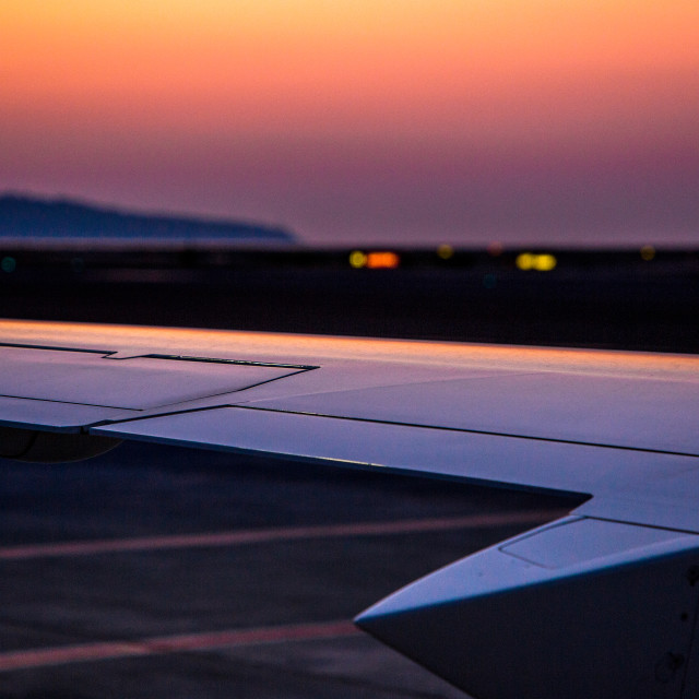 """section of aircraft wing against sunrise"" stock image"
