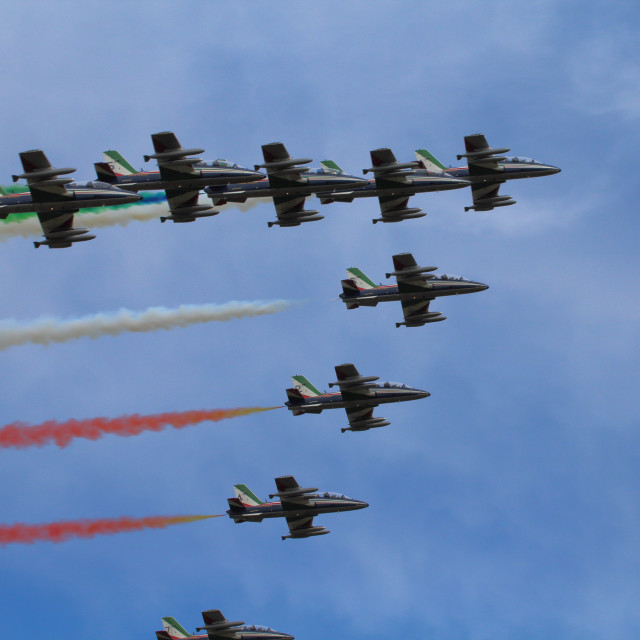 """Ferrara, Italy - September 07 2019: Frecce Tricolori (Tricolour Arrows)Italian acrobatic aircraft team during exhibition over Ferrara, Italy. Airshow performance at the Ballons Festival."" stock image"