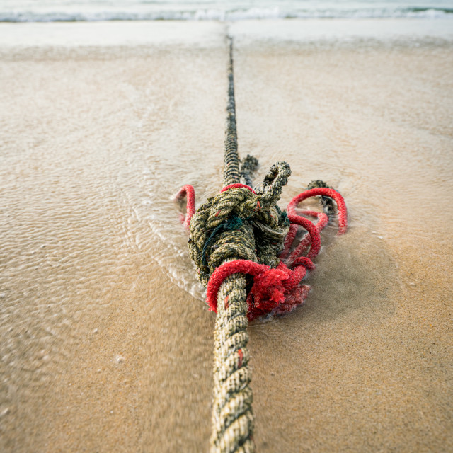 """""""Red knotted ships rope 7"""" stock image"""
