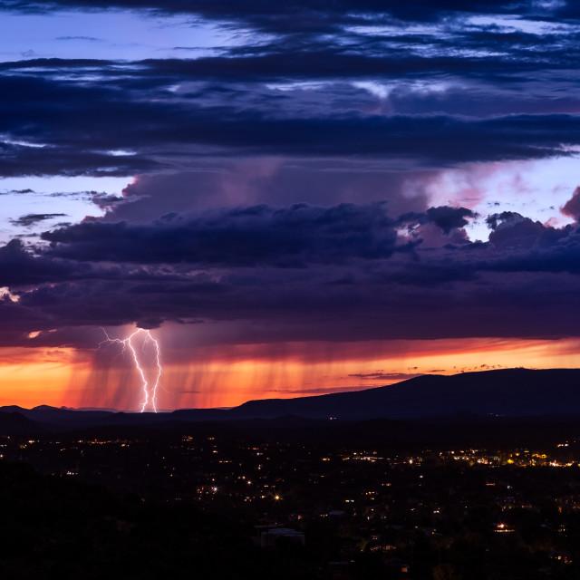"""Lightning from a thunderstorm near Sedona, Arizona at sunset"" stock image"