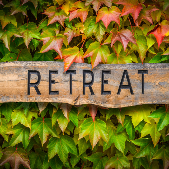 """Rustic Wooden Spiritual Retreat Sign"" stock image"