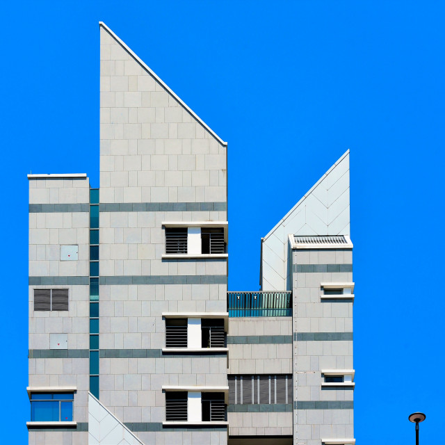 """Modern Apartment Tower against Blue Sky"" stock image"