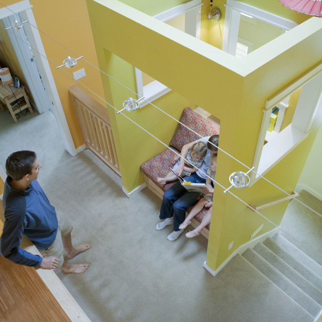 """""""High angle view of a family in the sitting room of a disability accessible home"""" stock image"""