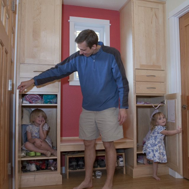 """""""Girls playing with their father in a disability accessible home"""" stock image"""