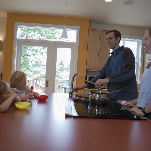 """""""Family in the kitchen of a disability accessible home"""" stock image"""