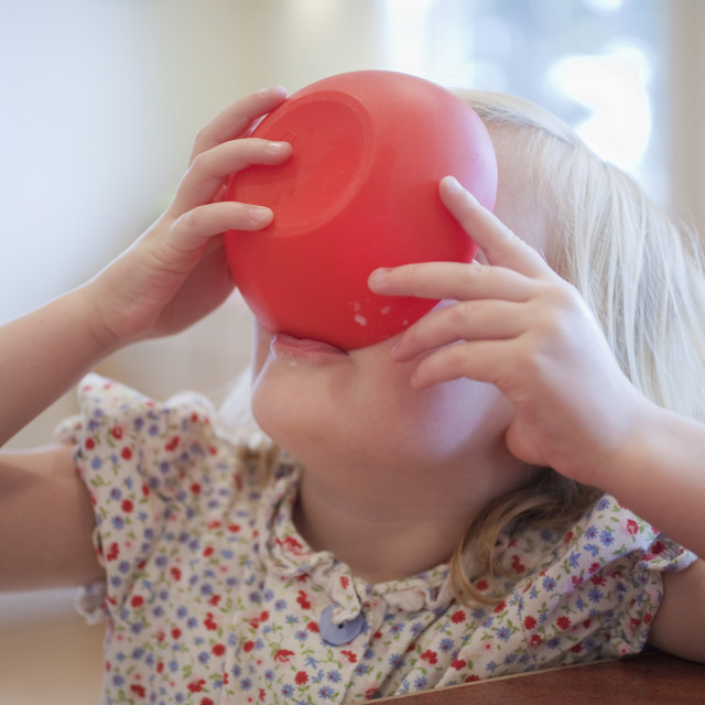 """""""Girl finishing bowl of food in a disability accessible home"""" stock image"""