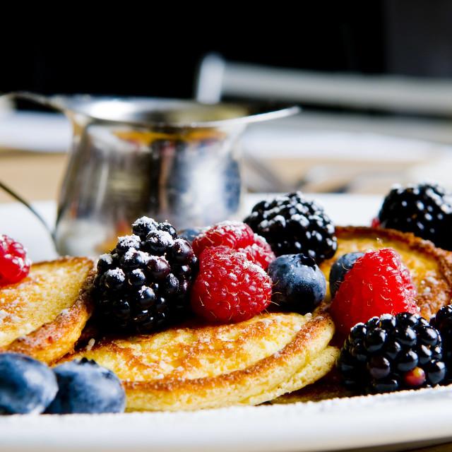 """Lemon ricotta pancakes with fresh berries"" stock image"