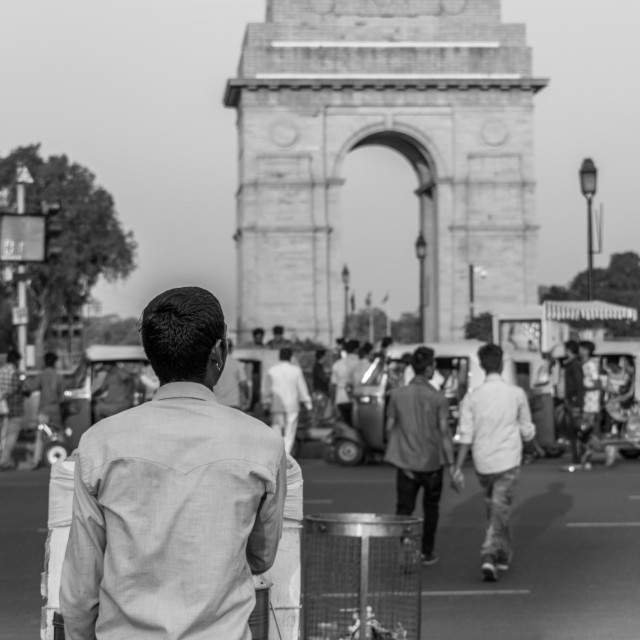 """A boy staring at the India Gate"" stock image"