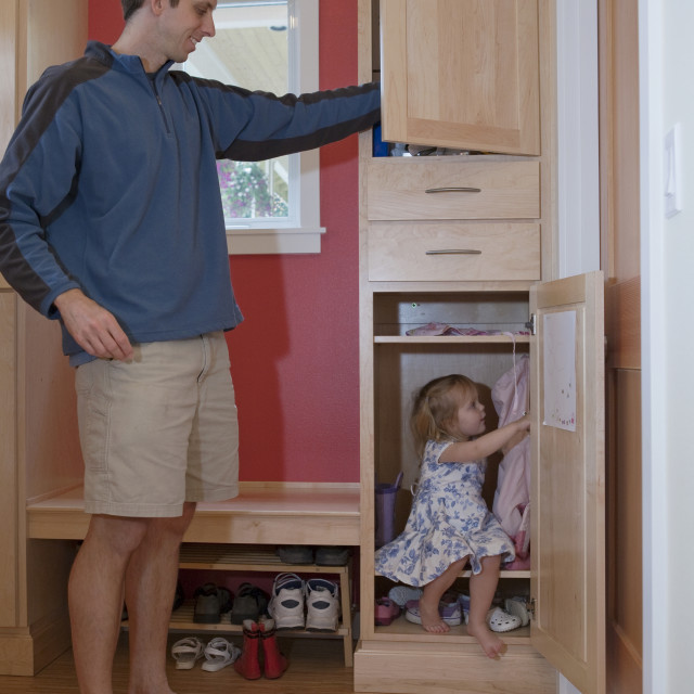 """""""Girl playing with her father in a disability accessible home"""" stock image"""