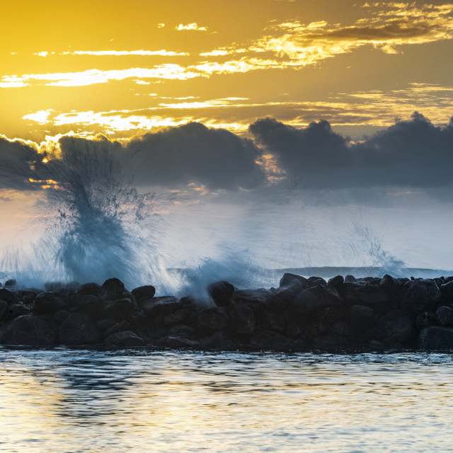"""""""Golden sunrise over Lydgate Beach and the ocean from the coast of Kauai with..."""" stock image"""