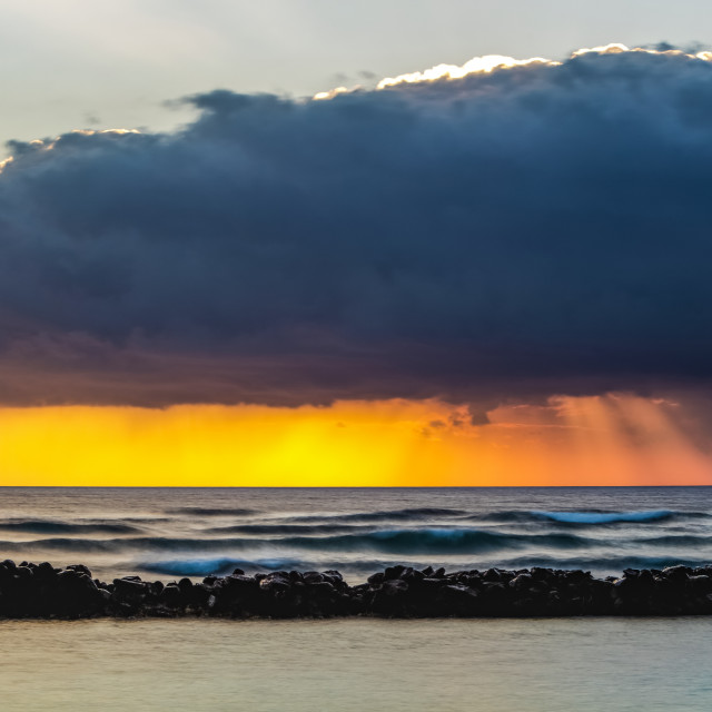 """""""Dramatic sunrise over Lydgate Beach, breakwater and the ocean from the coast..."""" stock image"""