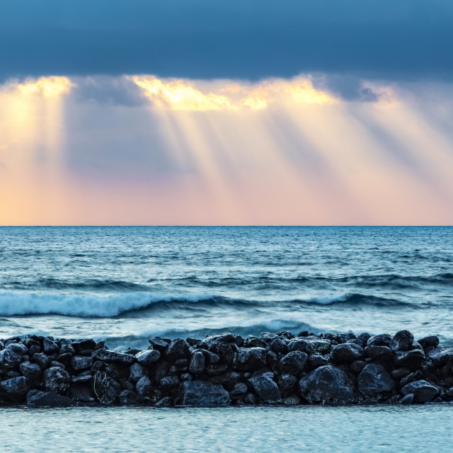"""""""Sunrise over Lydgate Beach and the ocean from the coast of Kauai with a..."""" stock image"""