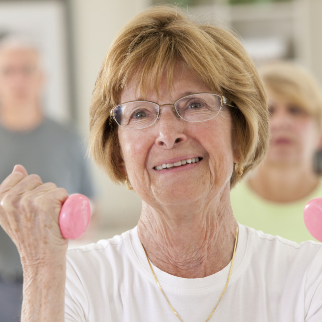 """""""Seniors exercising with dumbbells in a health club"""" stock image"""