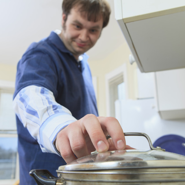 """""""Man with Asperger's living in his home and cooking"""" stock image"""