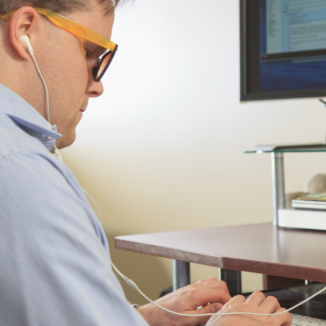 """""""Man with congenital blindness using assistive technology at his computer to..."""" stock image"""