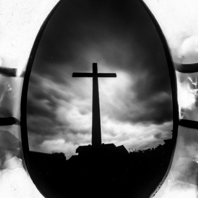 """Cross, Photographed using a chocolate easter egg."" stock image"