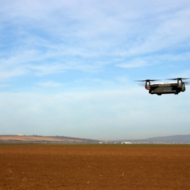 """""""The drone is flying over the plowed field technology and agricul"""" stock image"""