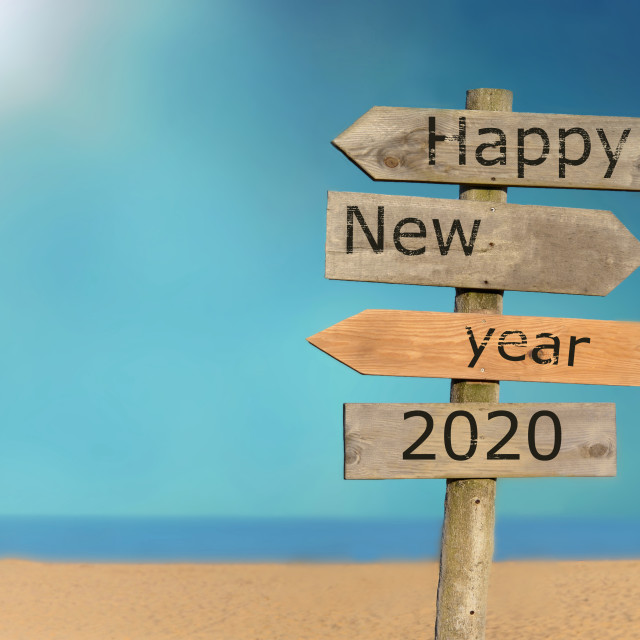 """""""wooden signpost happy new year 2020 on the sky and beach background"""" stock image"""