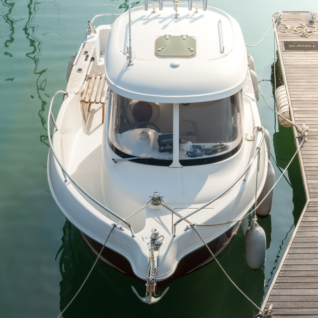 """""""small boat on calm water"""" stock image"""