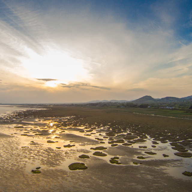"""low tide along the Co Louth coastline near Dundalk carlingford ireland aeril picture evening sunset"" stock image"
