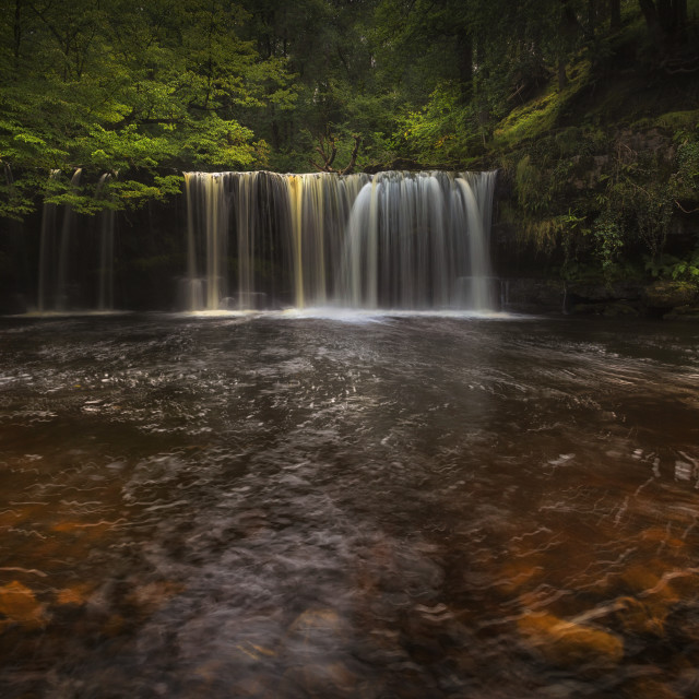 """""""A curtain of water at Sgwd Ddwli Isaf"""" stock image"""