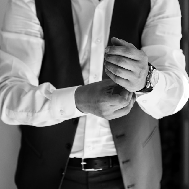 """""""Groom wearing his watch, close up detail"""" stock image"""