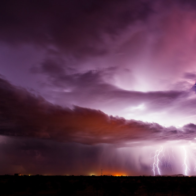 """Lightning bolts strike from a thunderstorm"" stock image"