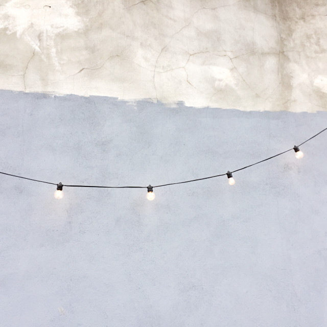"""Festoon lights on pastel wall"" stock image"