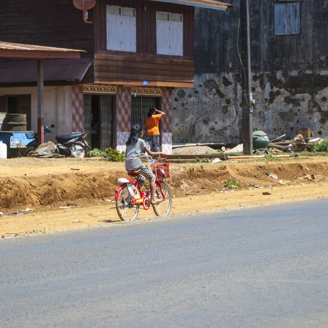 """Girl riding a bicycle, Laos"" stock image"