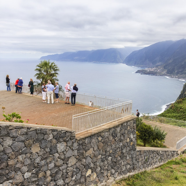 """Tourists on the viewpoint of Eira da Achada in Madeira"" stock image"