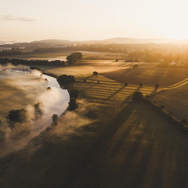 """""""Sunrise on a foggy morning"""" stock image"""