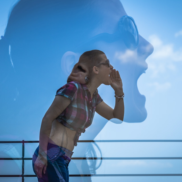 """""""Double exposure of young woman shouting"""" stock image"""