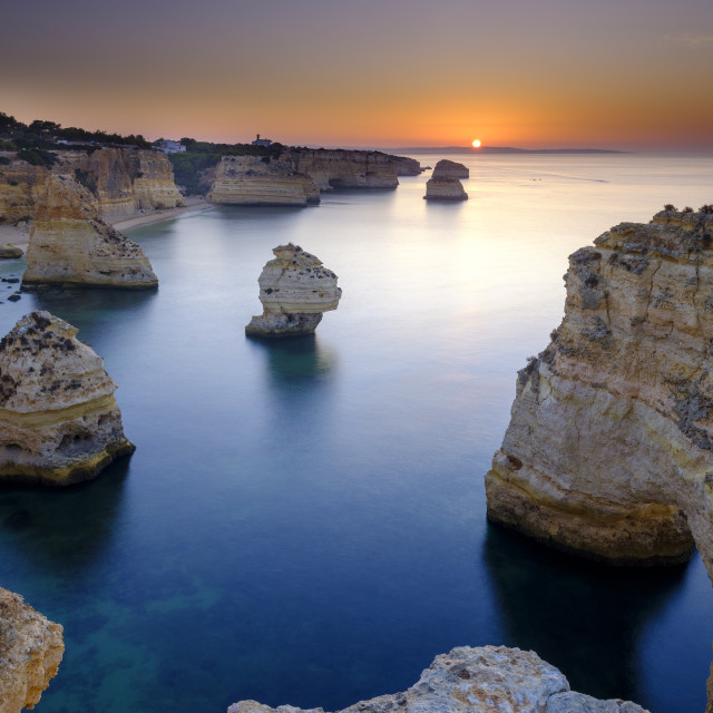 """Sunrise over Faro and the Algarve from near Plaia da Marinha, Po"" stock image"