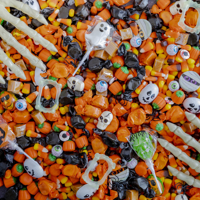 """""""Halloween candy spilled out on table"""" stock image"""