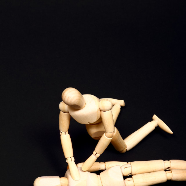 """""""Conceptual image of wooden manikins administering CPR resuscitation"""" stock image"""