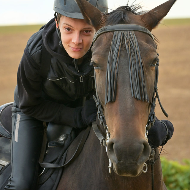 """""""Teenage boy with a horse"""" stock image"""