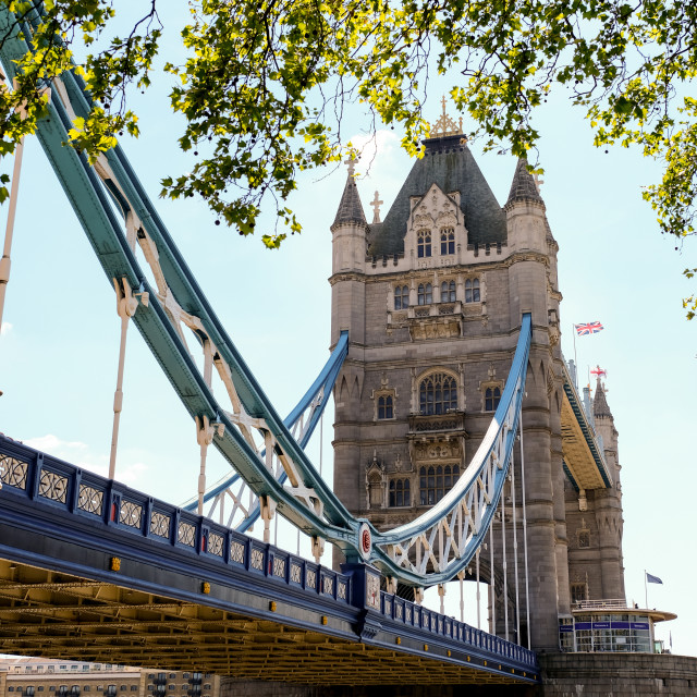 """""""Tower Bridge in London with bridge lowered and blue sky"""" stock image"""