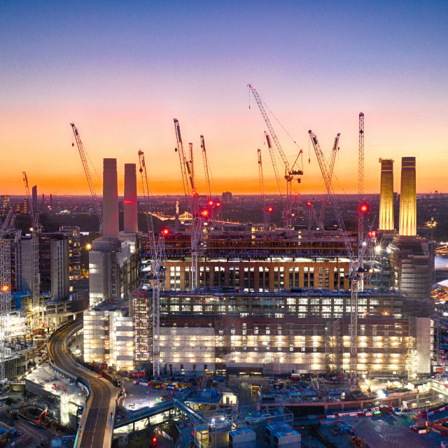 """""""The bright lights of the Battersea Power Station development light up the banks of the River Thames in London."""" stock image"""