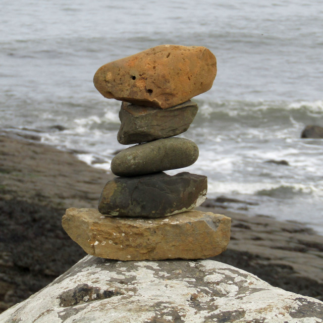 """Stacking stones on coast"" stock image"