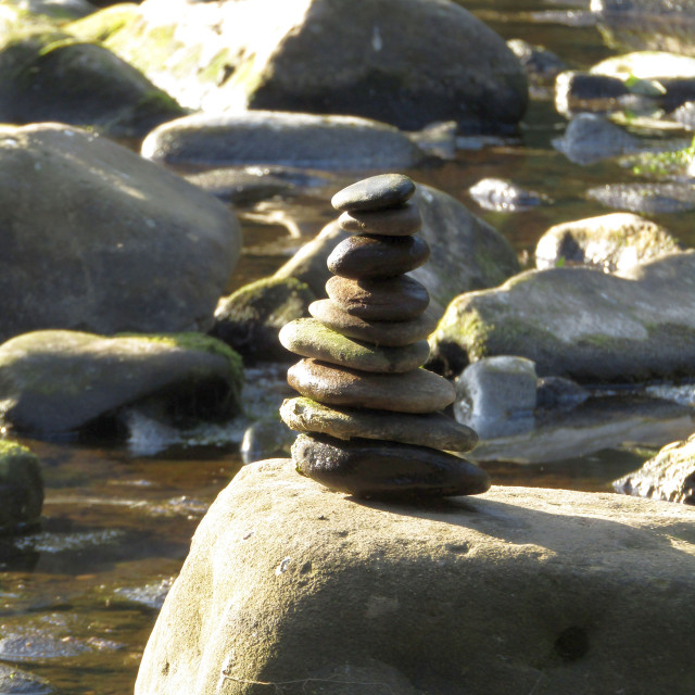 """Stacking stones on river"" stock image"