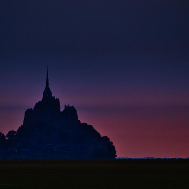 """Mont-Saint-Michel sunset silhouette"" stock image"