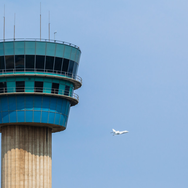 """Airport Control Tower Plane Departs"" stock image"