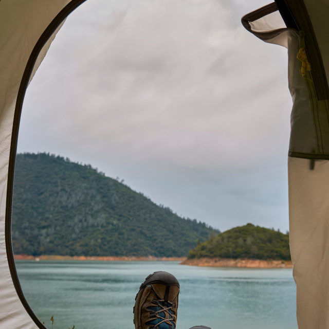 """Tent lookout on a lake while camping"" stock image"