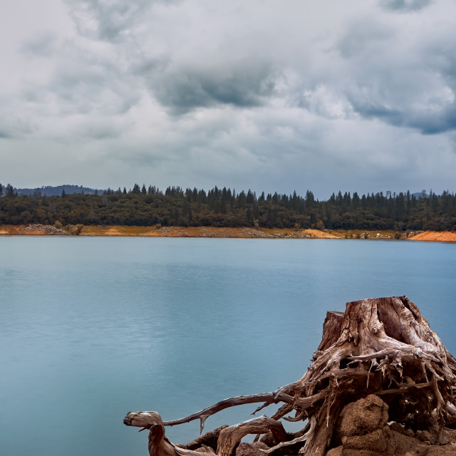 """Landscape of storm clouds moving over Lake Oroville"" stock image"