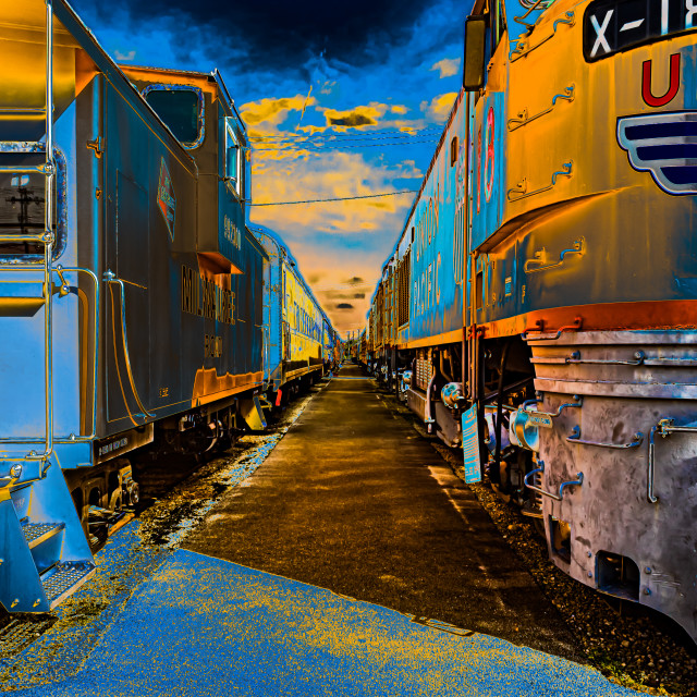 """Colorful Trains Sitting at the Station"" stock image"