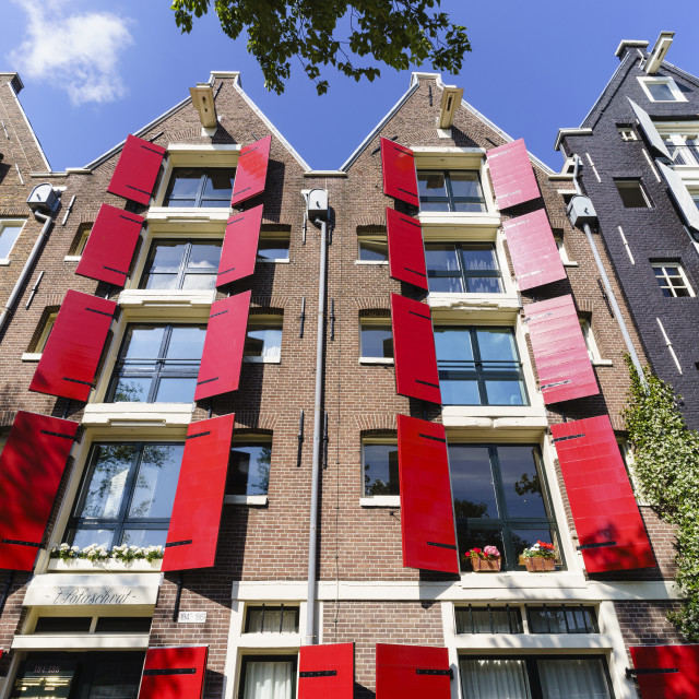"""""""Red shutters on traditional dutch style building, Amsterdam, Netherlands"""" stock image"""