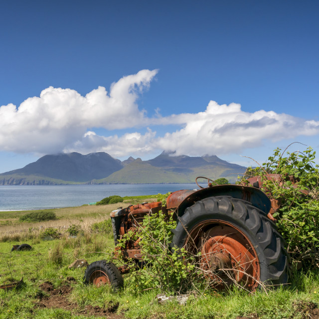 """An abandoned tractor on a Cleadale Croft, with distant view of The Isle of..."" stock image"