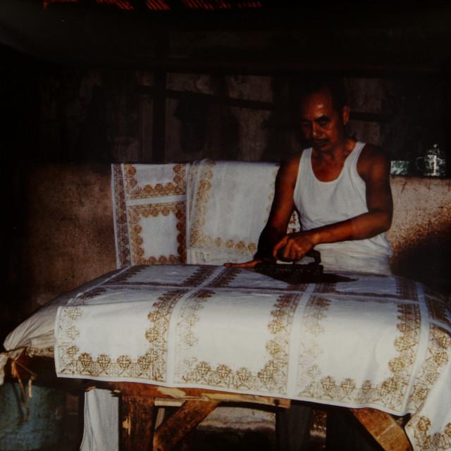 """Balinese man and batik"" stock image"