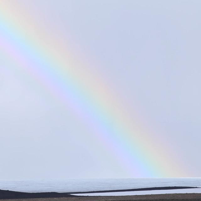 """Rainbow Touching Down on Langjokull Glacier, Iceland"" stock image"